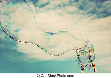 Blowing big soap bubbles in the air. Vintage freedom, summer...