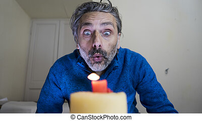 Blowing candle man