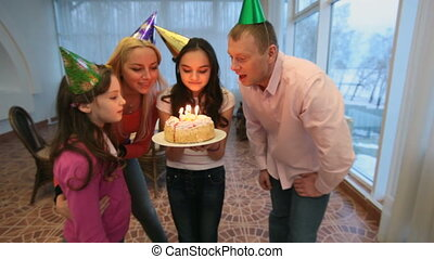 Blowing candles - Family blowing candles together