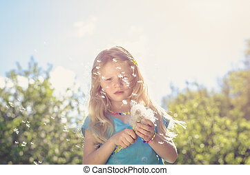 blowing dandelion seeds