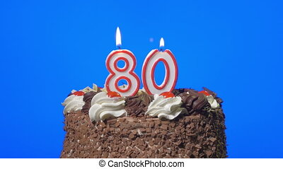 Blowing number 80 candles on a cake