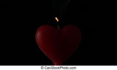 Blowing out a red heart candle. love concept - Blowing out a...