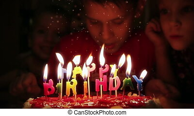 Blowing out candles - Boy blowing candles on birthday cake