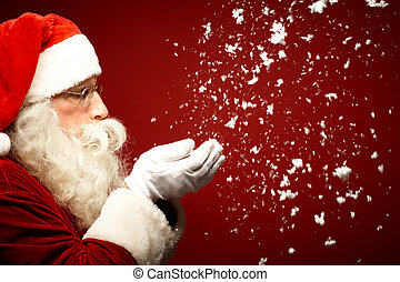 Blowing snow - Photo of Santa Claus blowing snow and looking...