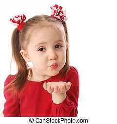 Blowing Valentine kisses - Portrait of a cute preschool girl...