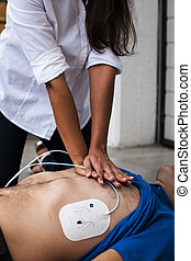 BLSD assistance - rescuer making cardiac compression chest
