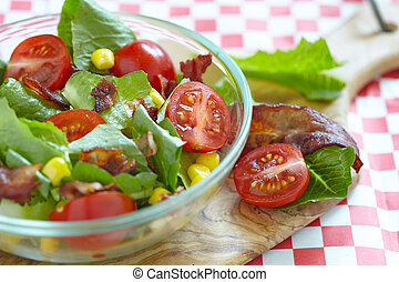 BLT salad - Fresh salad with bacon, lettuce, tomato and corn