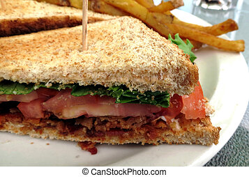 BLT Sandwich - Closeup of a plate with a bacon, lettuce and...