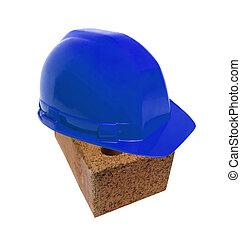 blu helmet on brick
