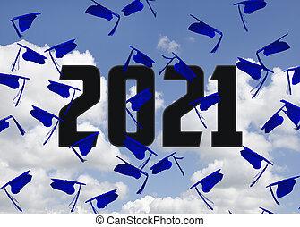 blue 2021 graduation hats in sky