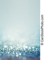 Blue abstract background with defocused sparkle lights and...