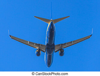 blue airplane takeing off - a blue commercial airplane close...