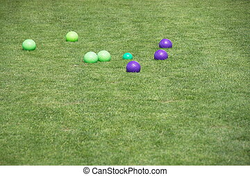 Blue and Green Bocce Balls on Cut Green Grass