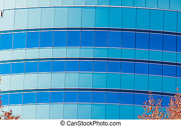 Blue and Green Glass on Office Building