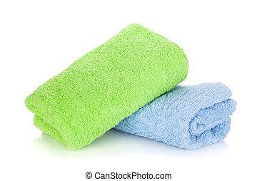 Blue and green towels. Isolated on white background