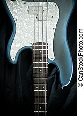 Blue and ivory bass guitar - A blue and ivory bass guitar...