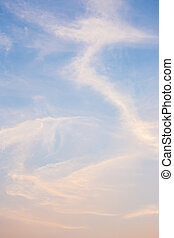 Blue and orange sky with clouds background.