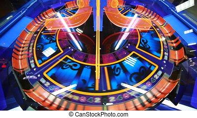 blue and orange slot machine, that rotates, child slots