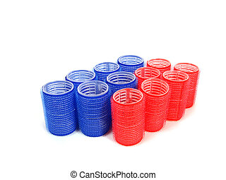 blue and red hair curlers over white background