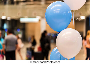 Blue and white baloons at reception hall