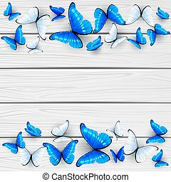 Blue and white butterflies on wooden background