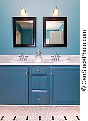 Blue and white classic modern new bathroom with double sinks.