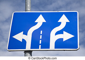 Blue and White Double Arrow Sign