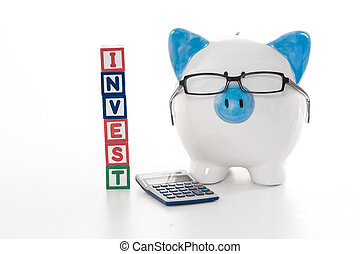Blue and white piggy bank wearing glasses with invest building blocks and calculator