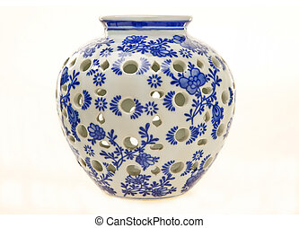 Blue and white antique pottery ginger jar isolated on white.