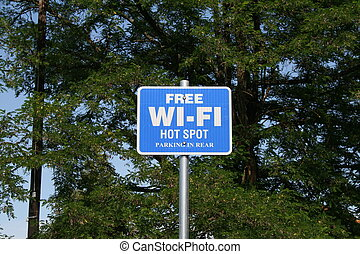 blue and white sign advertising free wi-fi hot spot with parking.