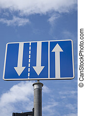 Blue and White Triple Arrow Sign