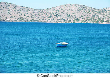Blue and white wooden boat at a Mediterranean sea (Greece)