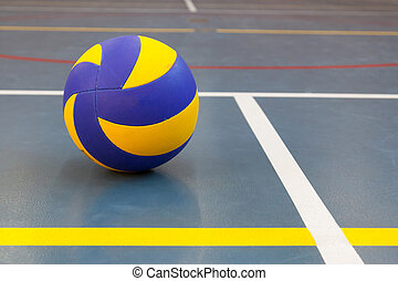 Blue and yellow ball on blue court at break time, school gym