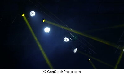 Blue and yellow light on the stage. Soffits shine at a...