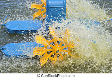Waterwheel - blue and yellow Waterwheel in a pond of shrimp