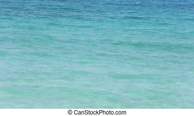 Blue aquamarine sea flowing water surface with waves and...