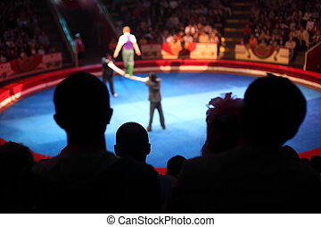 blue arena in circus performance with acrobat on bean focus ...