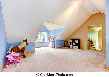 Blue attic living room with toys and play area with vaul ceiling.
