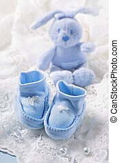 Blue baby shoes on a white fabric
