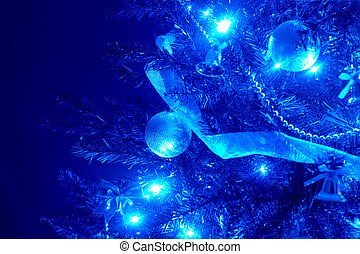 Blue background with christmas tree, ball, light. Abstract.