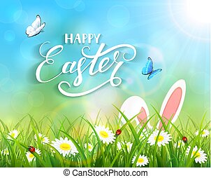 Blue background with Easter bunny in grass