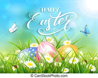 Blue background with three Easter eggs in grass