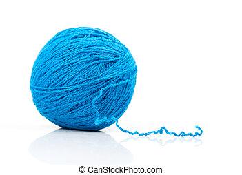 Blue ball of yarn on white