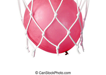 Blue balloon in a basketball net. Accurate throw in the ring...