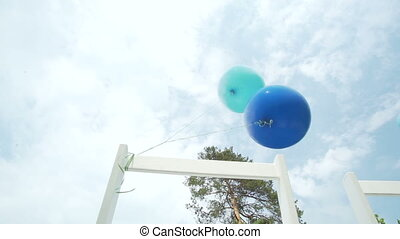 blue balloon tied to a white chair