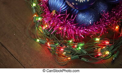 Blue balls in a wicker basket and garland flashing....