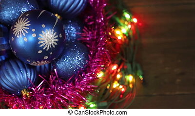 Blue balls in a wicker basket and garland