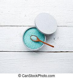 Blue bath salt in cup