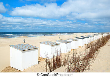 Row blue and white beach cabins for vacation purposes