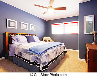 Blue bedroom interioe with navy bedding.